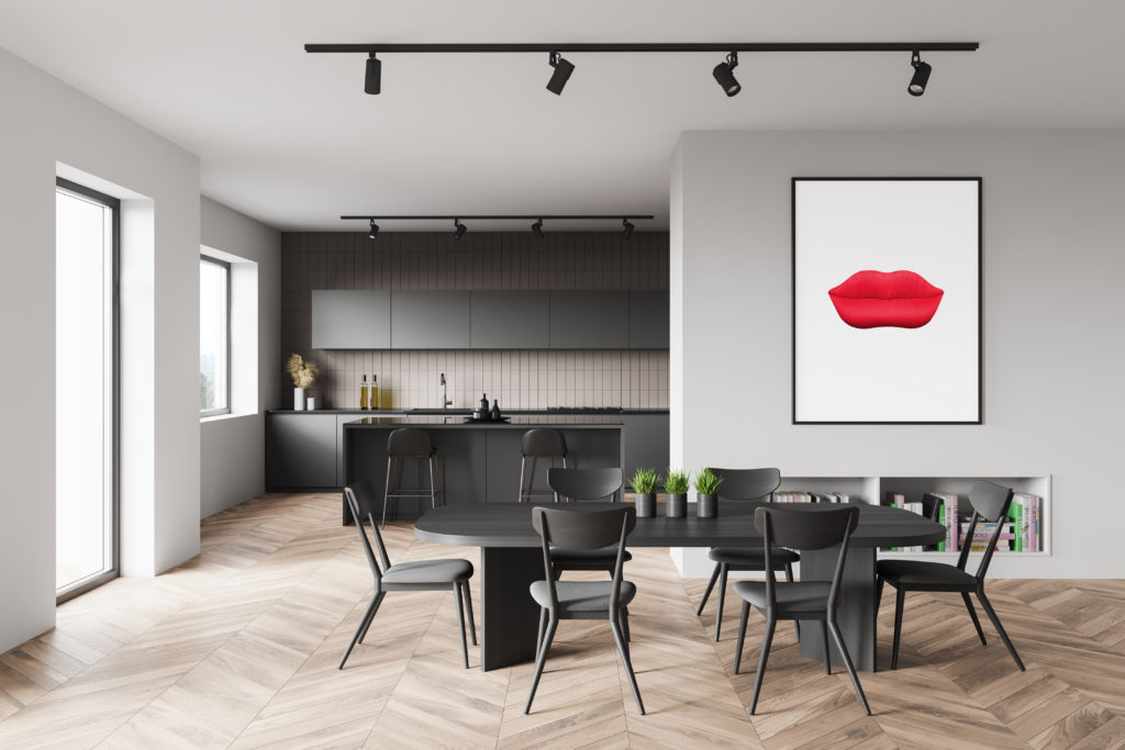 White and beige kitchen with table and poster